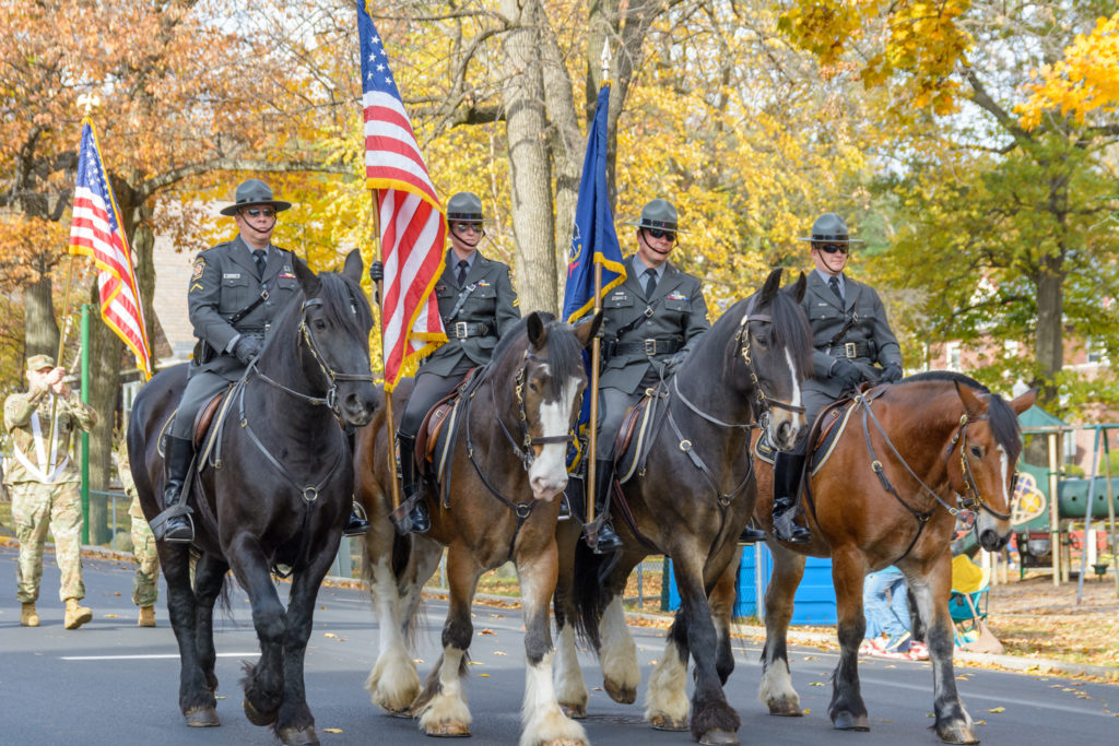 Pennsylvania State police on horseback, part of the Carbon County Veterans Parade in Palmerton, PA.