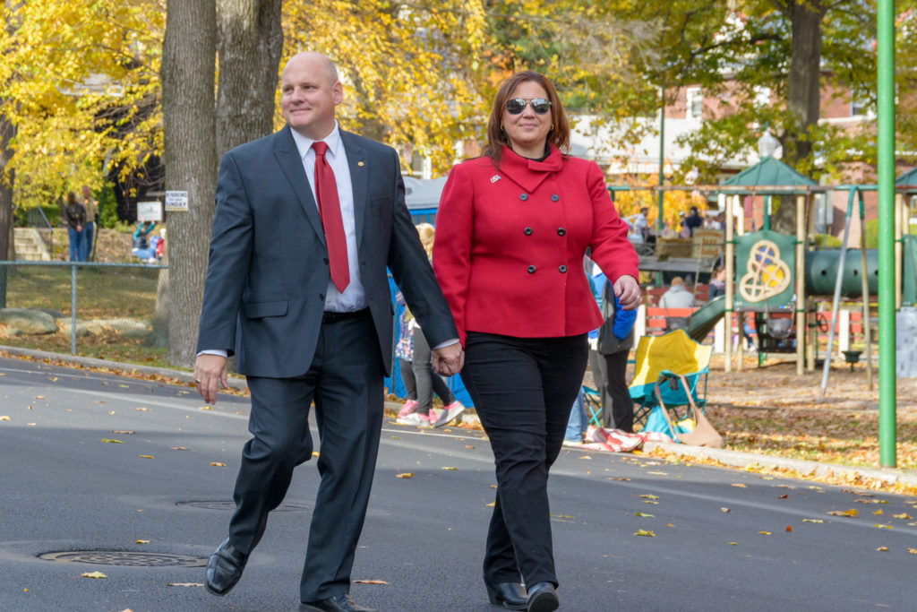 Doyle Heffley and his wife walking in the Veterans Parade