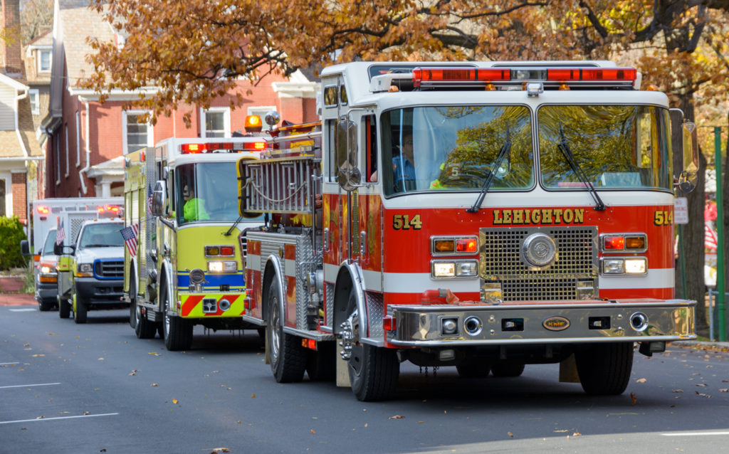 Several Lehighton Fire department trucks in the Veterans parade held in Palmerton, PA.